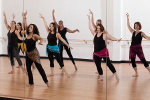 Oreet teaches a group of students a bellydance workout